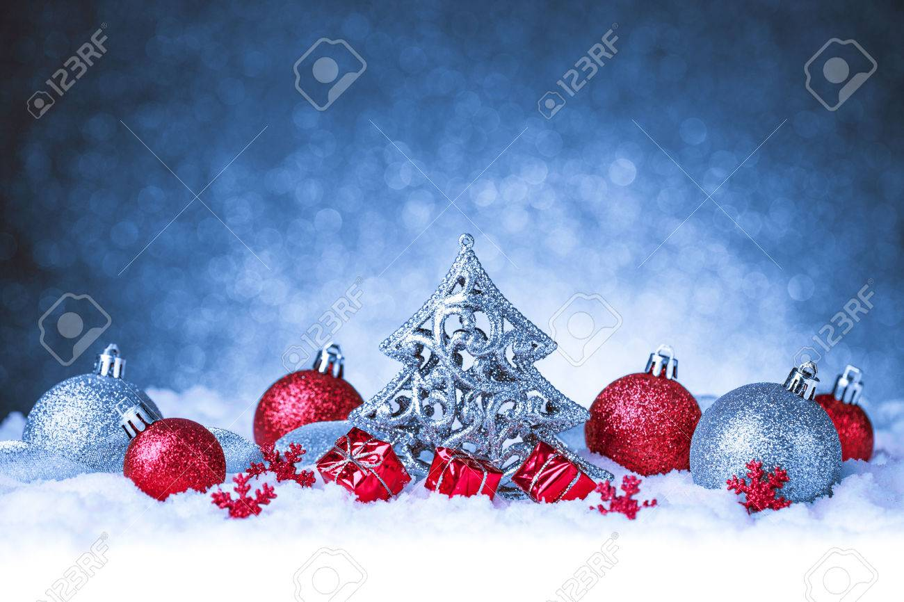 christmas ornament in snow on glitter background. studio shot Stock Photo - 33796691