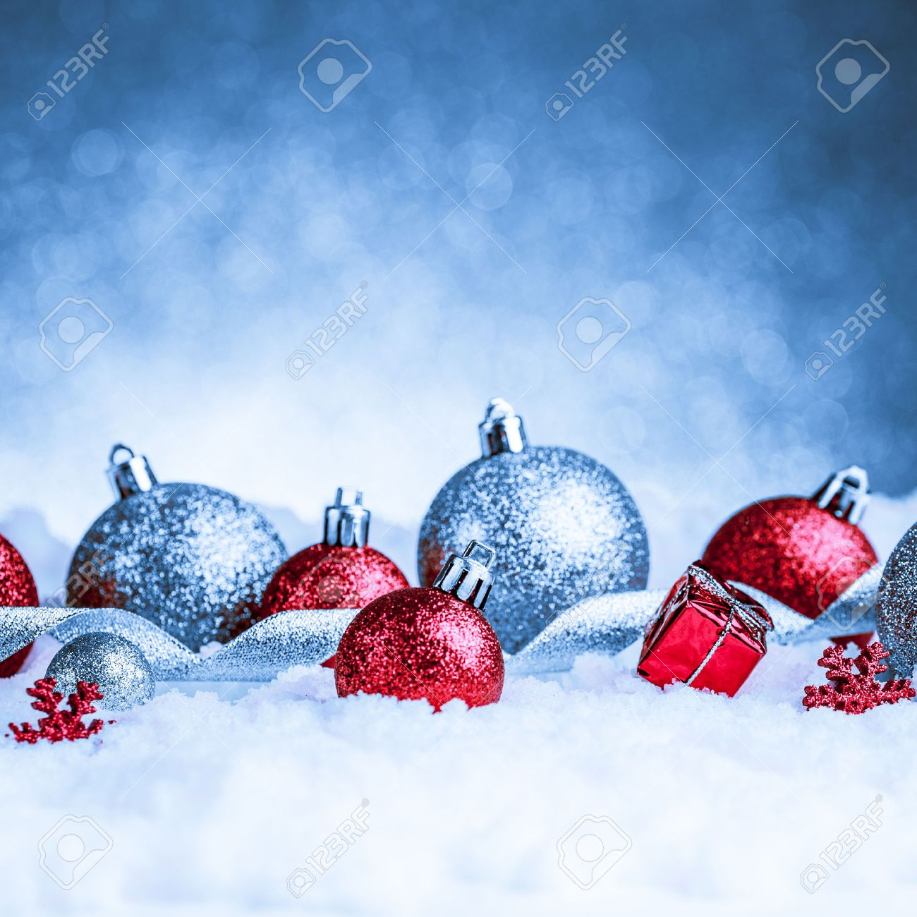 christmas ornament in snow on glitter background. studio shot Stock Photo - 34400663