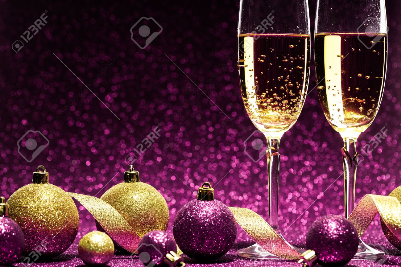 two glasses of champagne ready for christmas celebration, on purple background Stock Photo - 34380461
