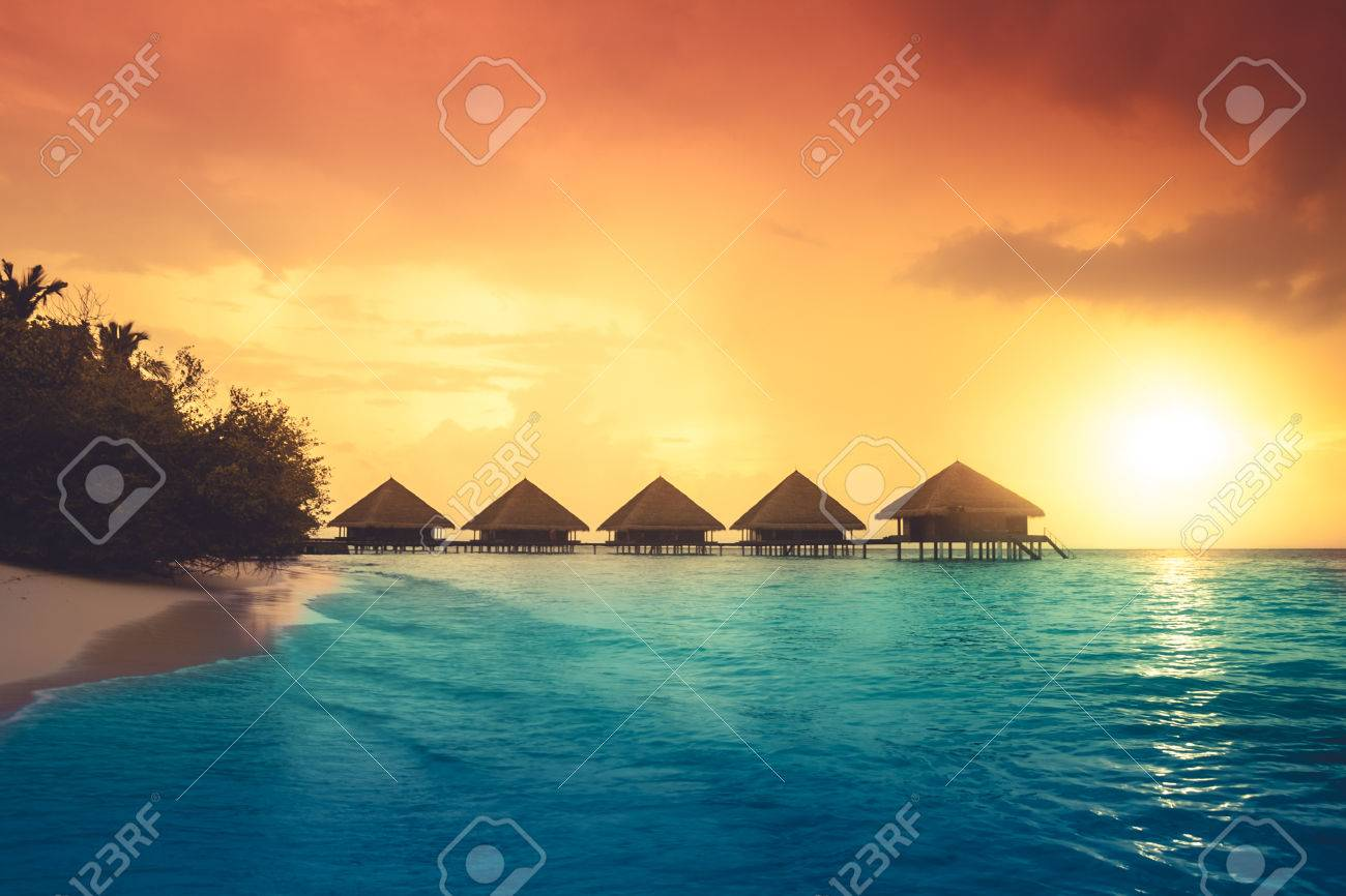 Over water bungalows with steps into amazing green lagoon Stock Photo - 43009881