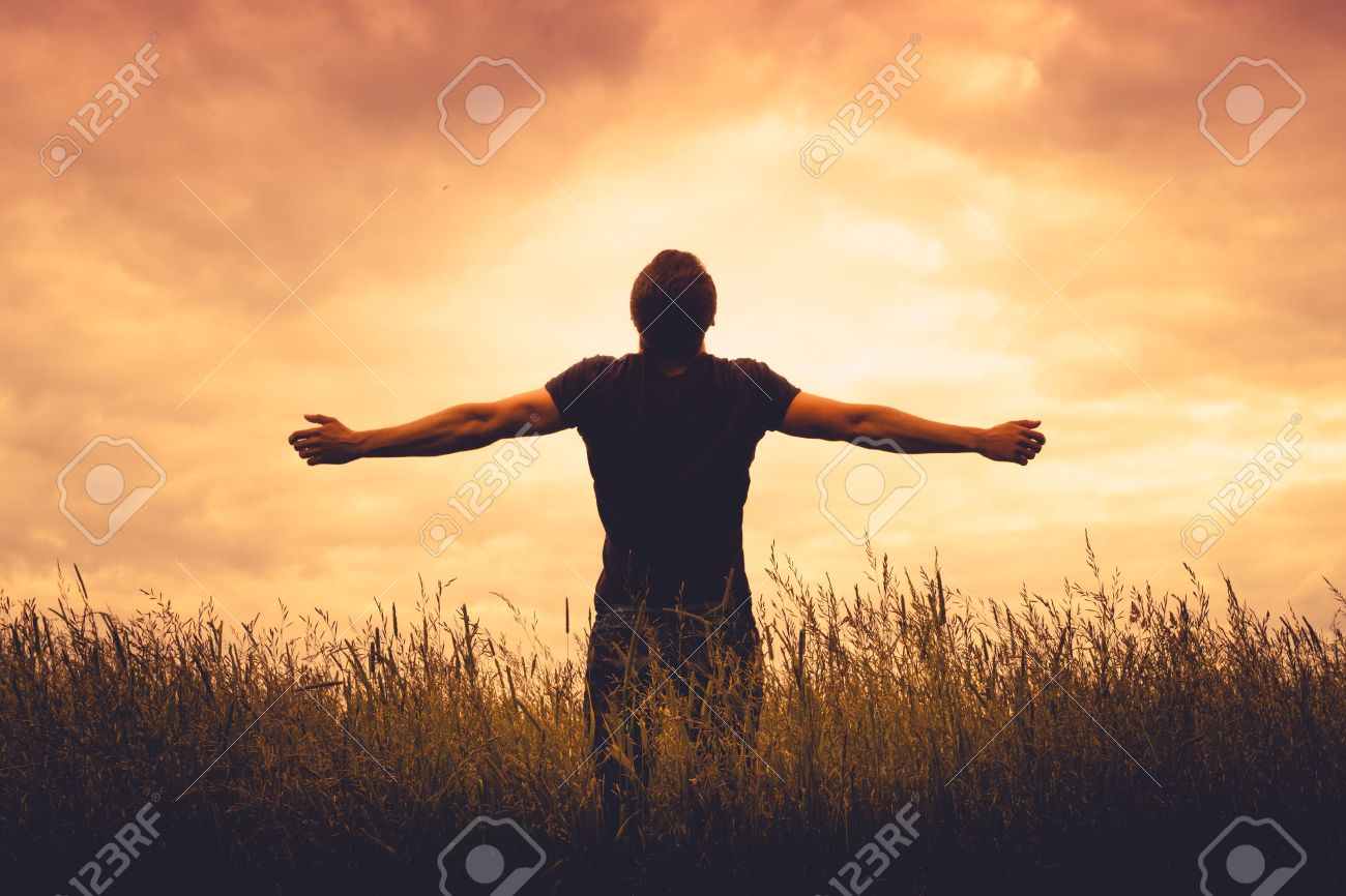 Silhouette Of Man Standing In A Field At Sunset Stock Photo, Picture And Royalty Free Image. Image 43577262.