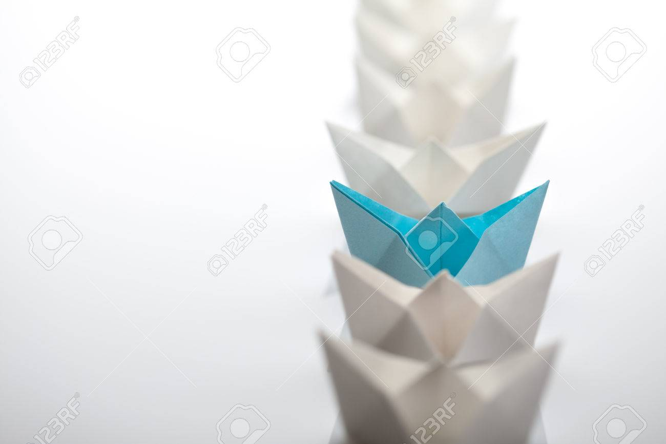 Leadership concept using paper ship among white Stock Photo - 43677453