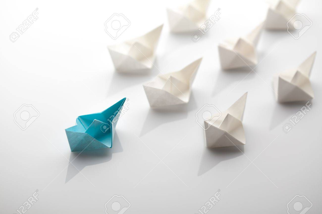 Leadership concept using blue paper ship among white Stock Photo - 43895281