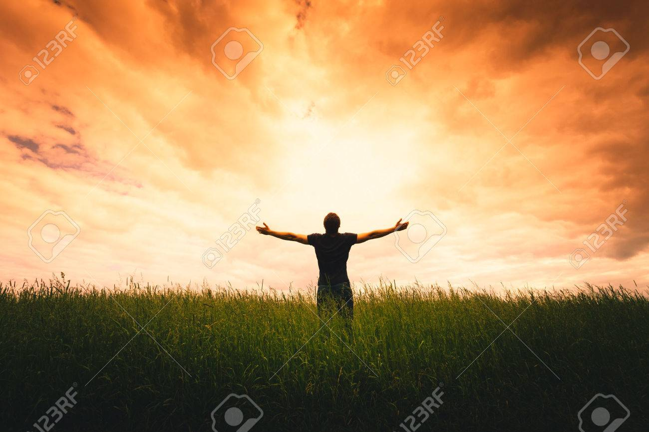 Silhouette of man and sunshine on sky background. Stock Photo - 44344028
