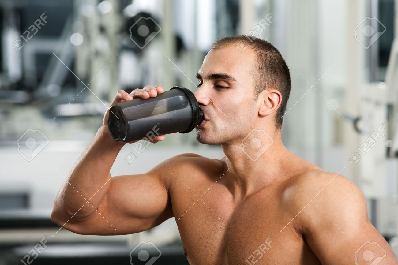 bodybuilder in the gym, drinking a protein shake Stock Photo - 12859829