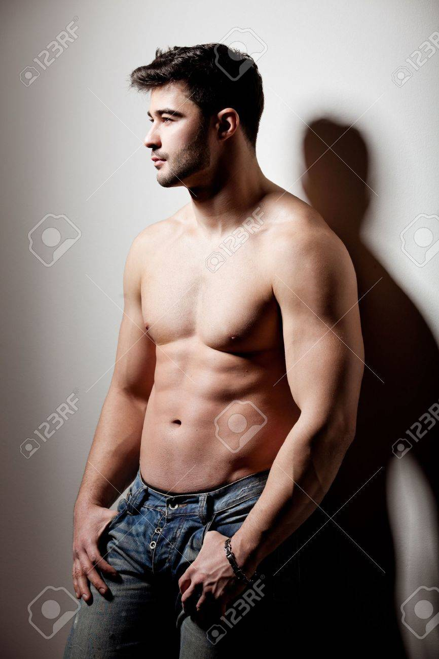 artistic shot of a handsome young man propped on the wall Stock Photo - 12859887