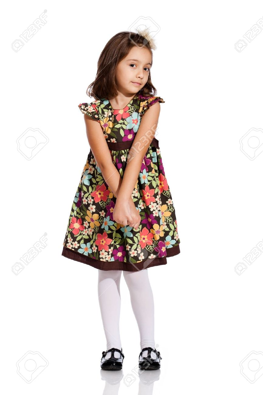 pretty little girl, wearing a beautiful colored dress, isolated on white background Stock Photo - 13256274