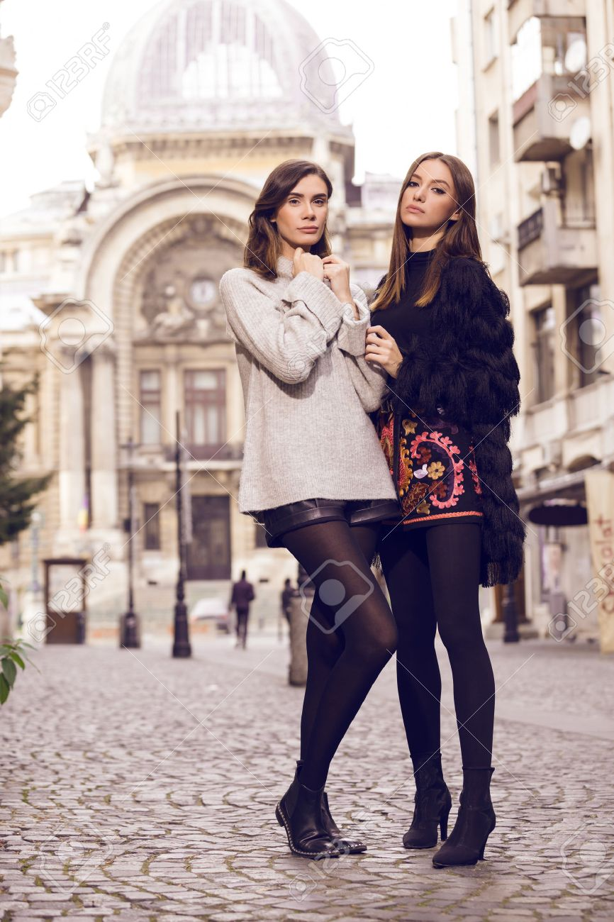 9742fd4fe43 ... beautiful fashion models posing outside wearing a grey sweater with leather  shorts