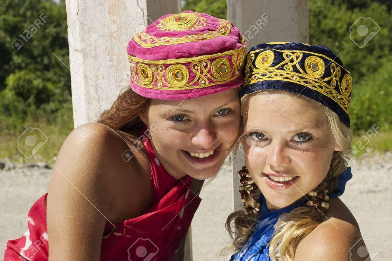 Two girls in skullcaps Stock Photo - 17480134