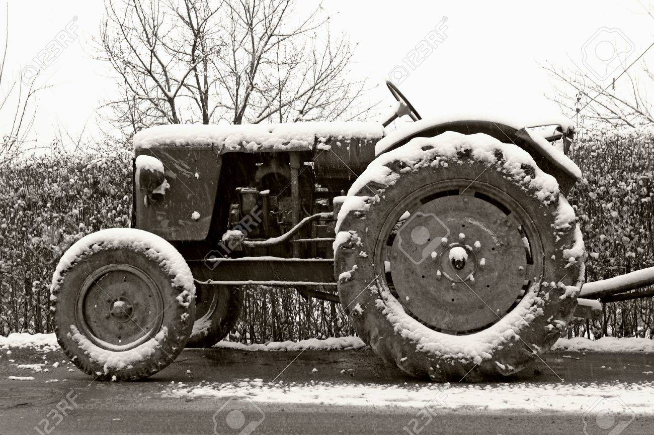 black and white photograph of classic old tractor in winter Stock Photo - 626500