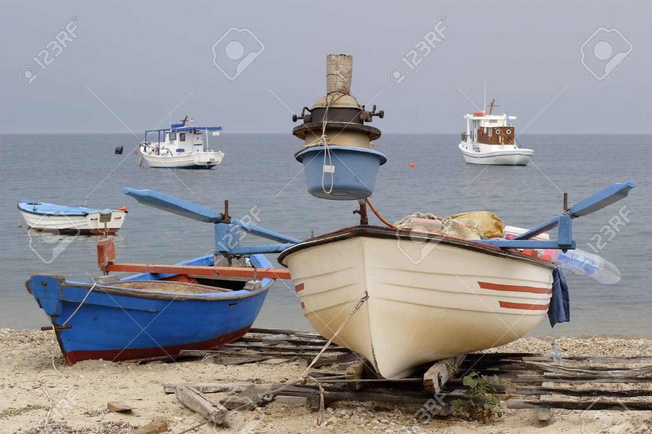 greek fishing boats anchored off the beach Stock Photo - 636640