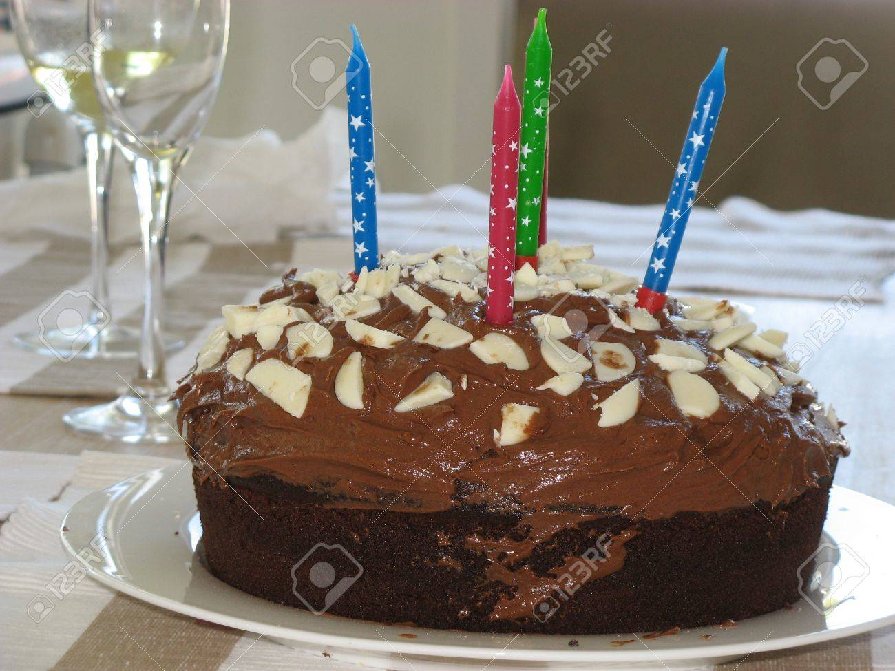 Birthday Cake With Candles And Wineglass Stock Photo