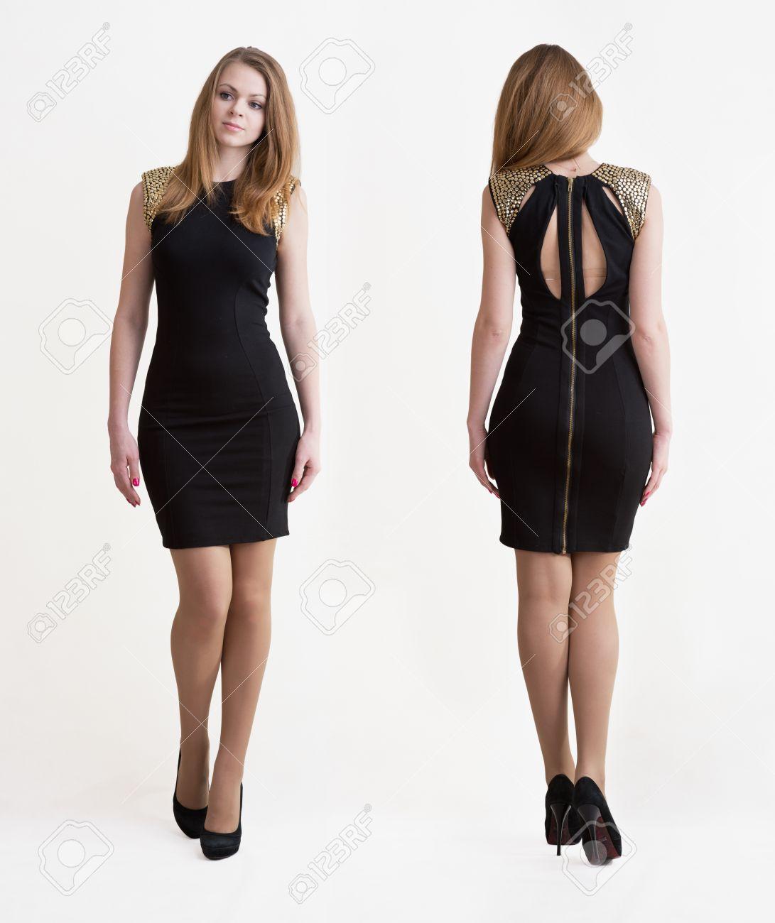 ff25f180f Chica rubia joven en vestido corto negro con la máxima de tacón alto Foto  de archivo