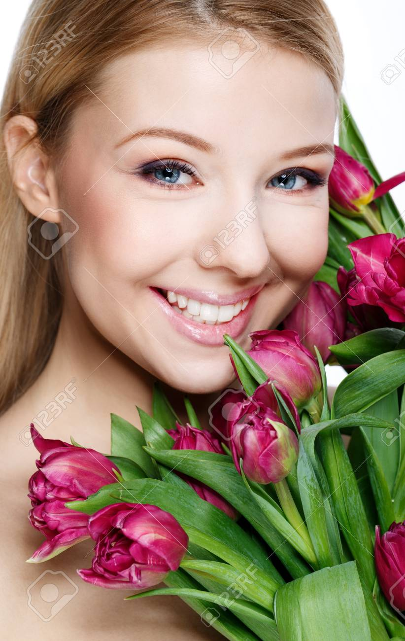 Beautiful blonde with flowers Stock Photo - 18285522