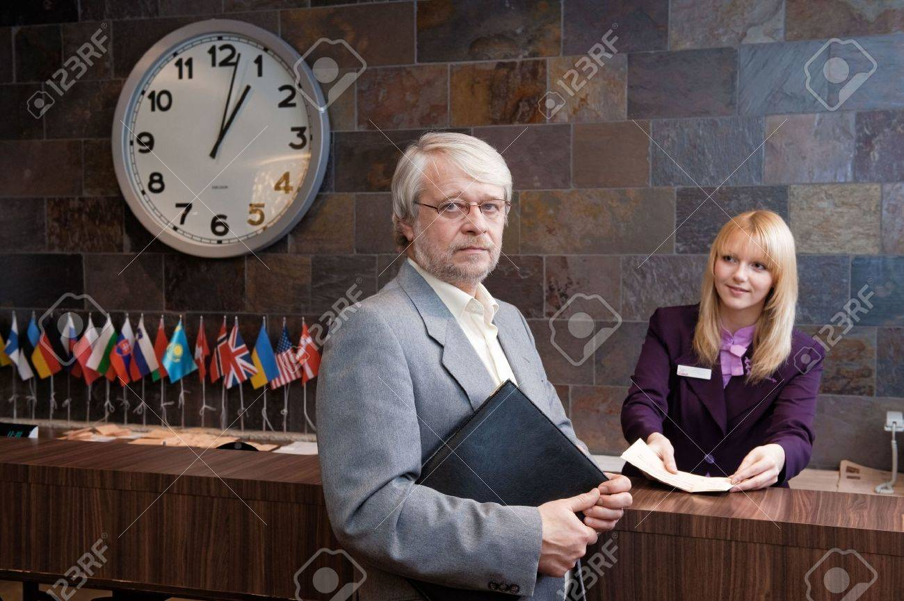 Businessman checking in at the reception desk Stock Photo - 6184778