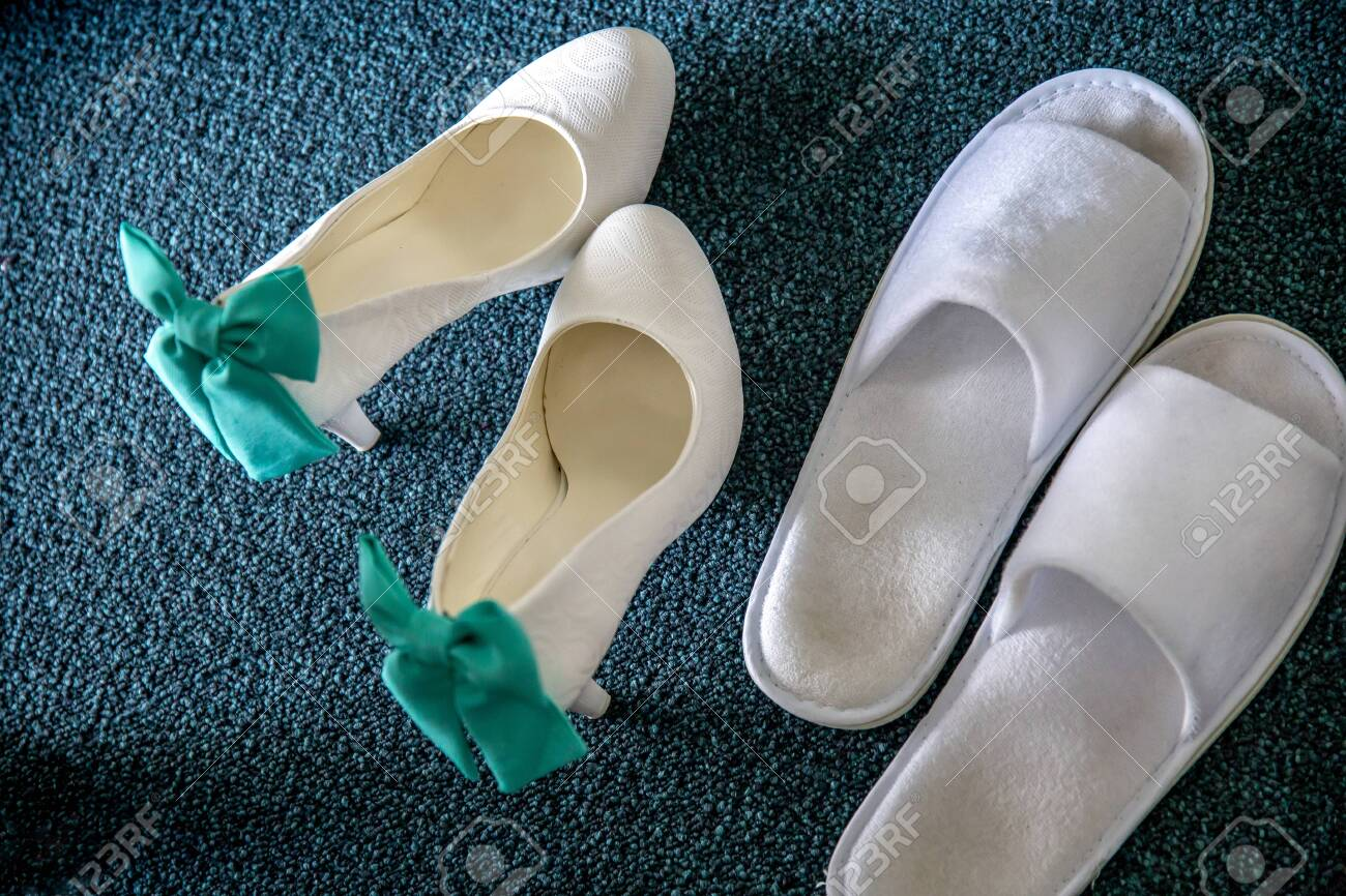 d7e72bdd199 White bridal shoes and wedding slippers on carpet. Wedding shoes..