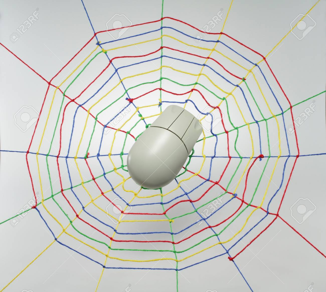 Colorful ribbons create a spider web many links and cross each other. Stock Photo - 9089261