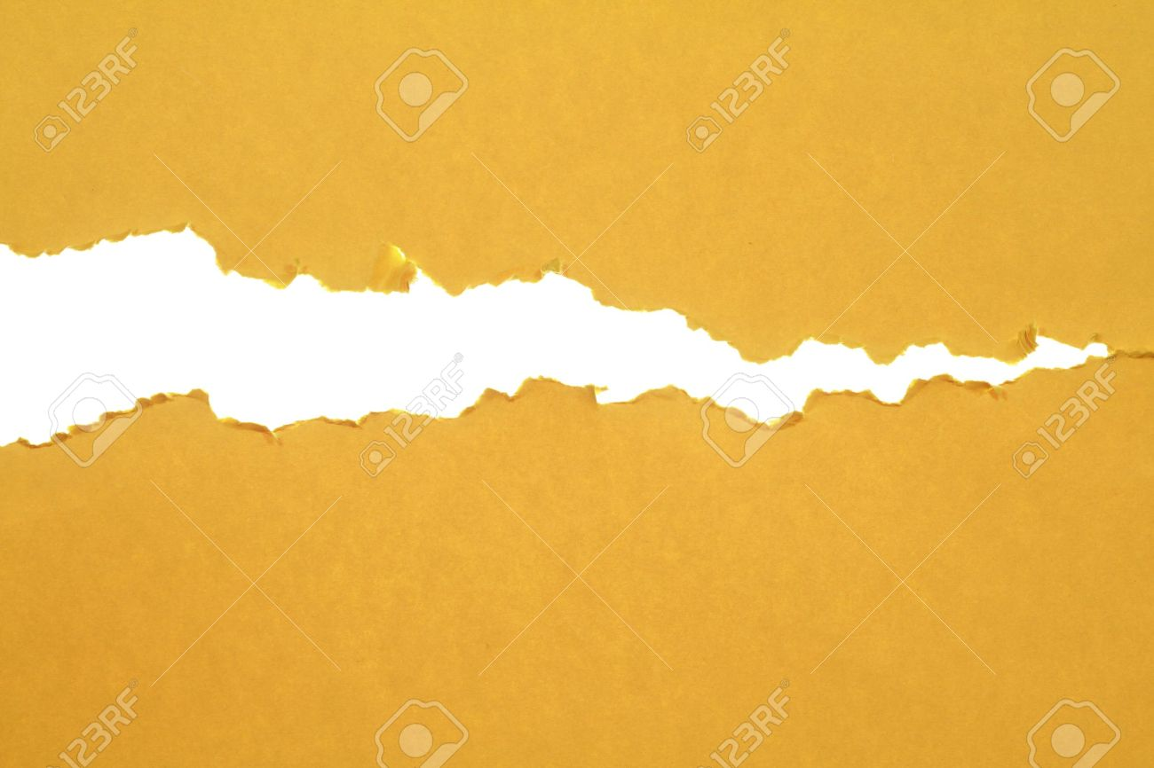 A Sheet Of Paper Was Torn Apart By Force. Stock Photo   11552956