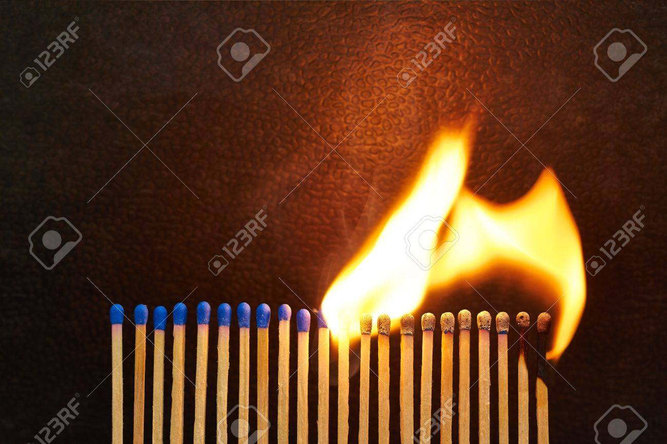 A series of matches are next to each other, which burn one after another Stock Photo - 22089054