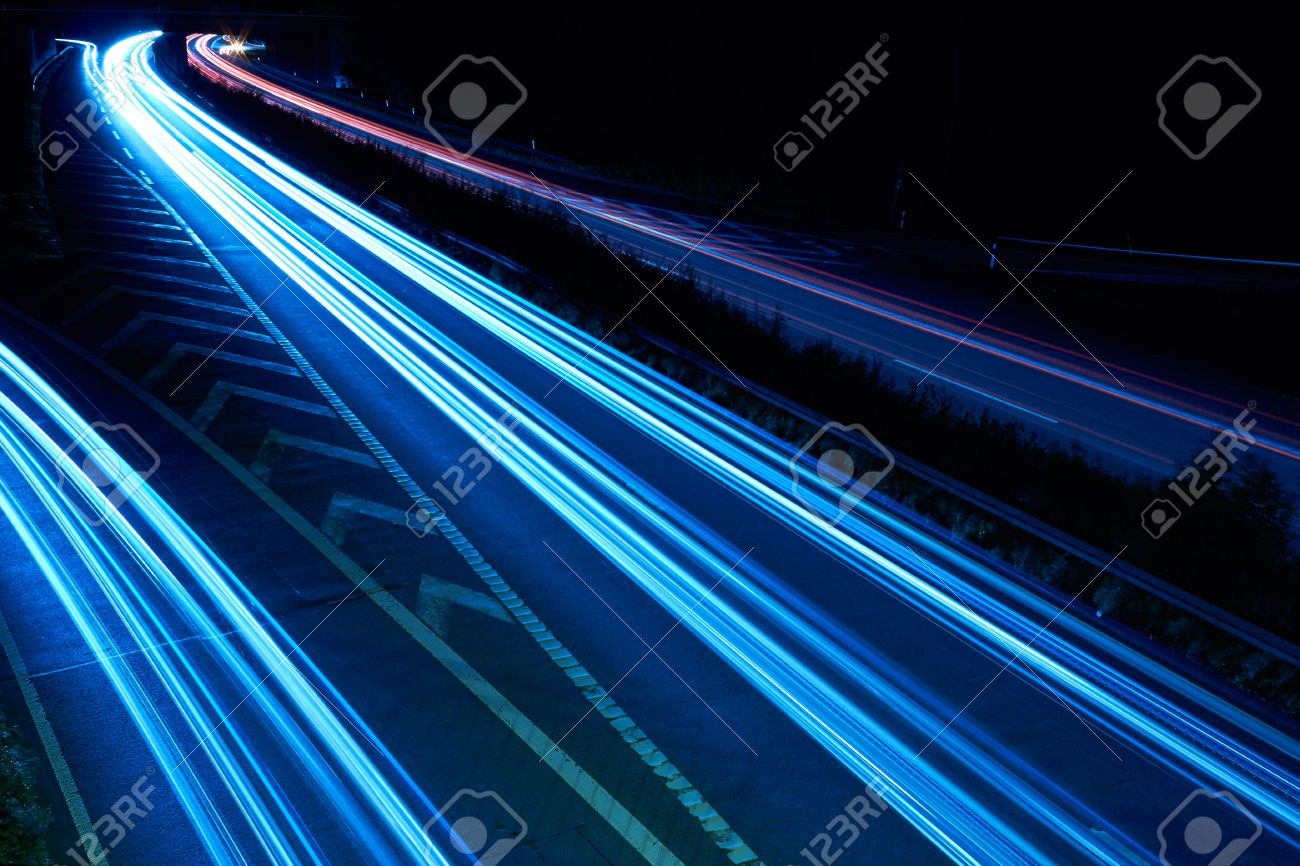 On the night propelled at a long exposure light trails produce cars with their headlights Stock Photo - 23019080