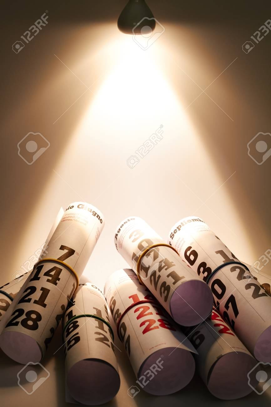 A beam of light comes from above and illuminated pages of a calendar Stock Photo - 23023814