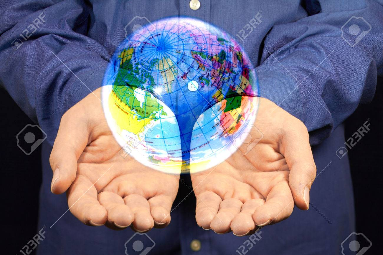 A Magic Globe Hovering Above Two Hands Stock Photo Picture And Royalty Free Image Image 33477135