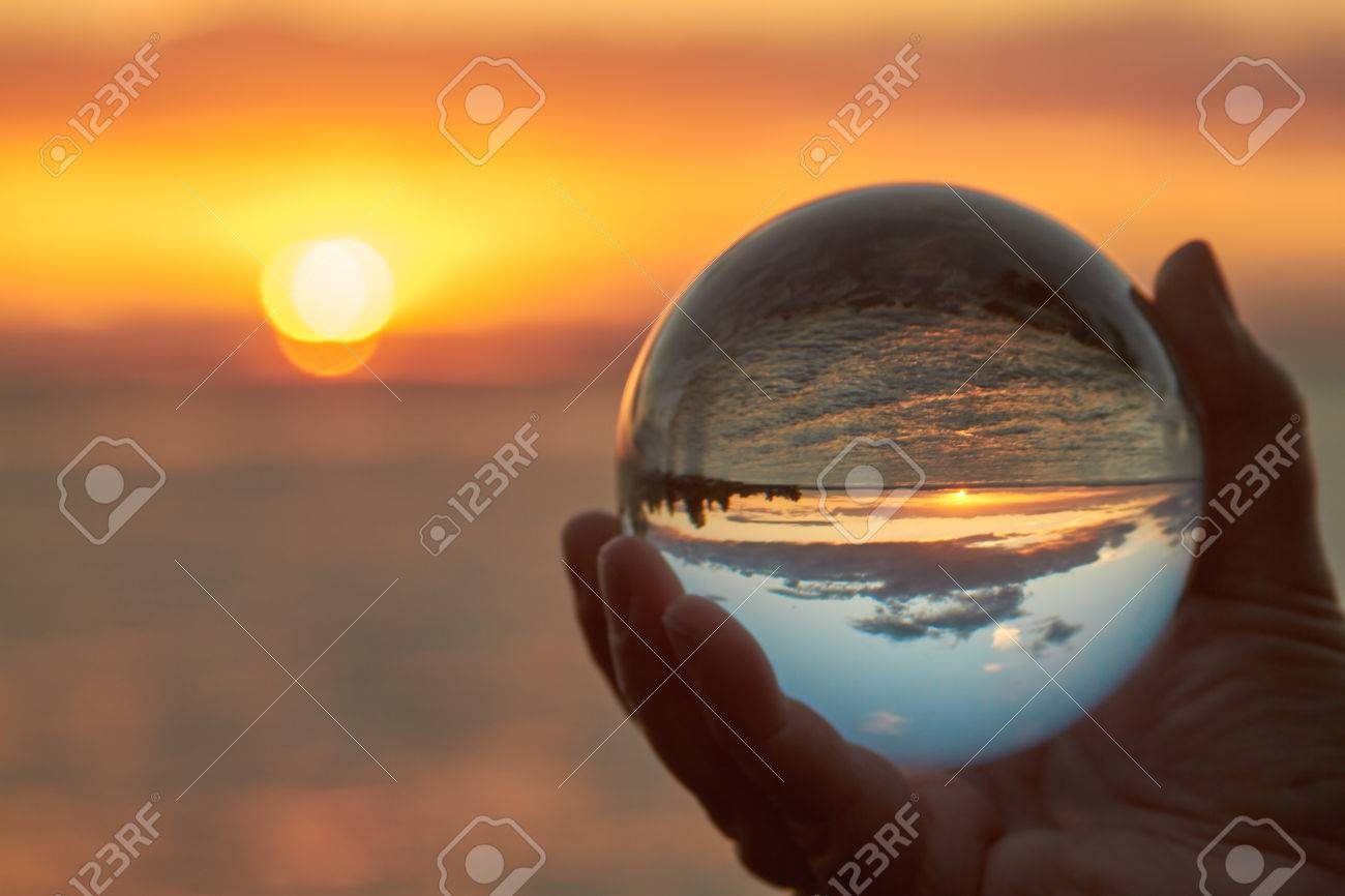 The sun sets over Lake Constance in Germany and lit by a crystal ball. - 43818412