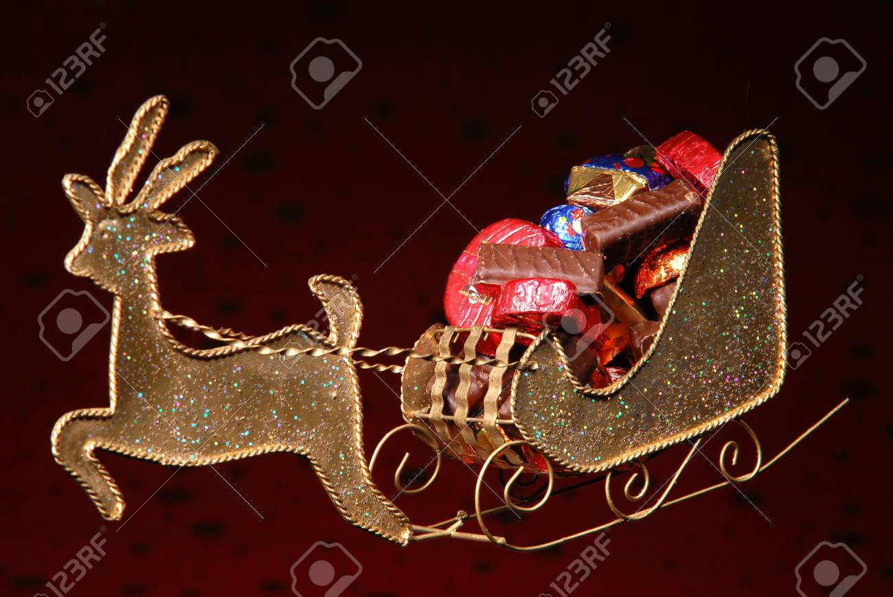 sweets on golden sleigh of Santa Claus Stock Photo - 16283529