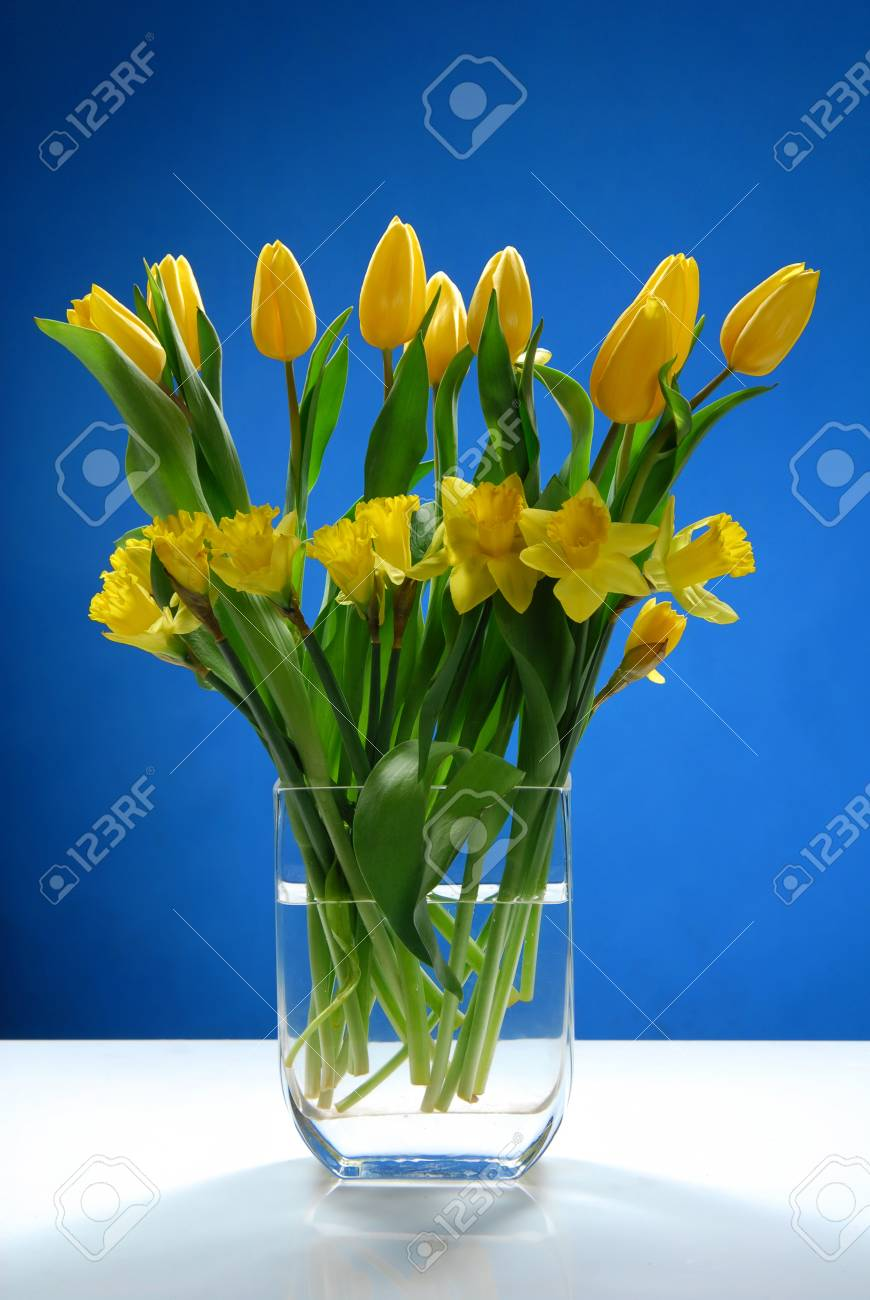 A Bouquet Of Yellow Flowers With Green Leaves Stock Photo Picture