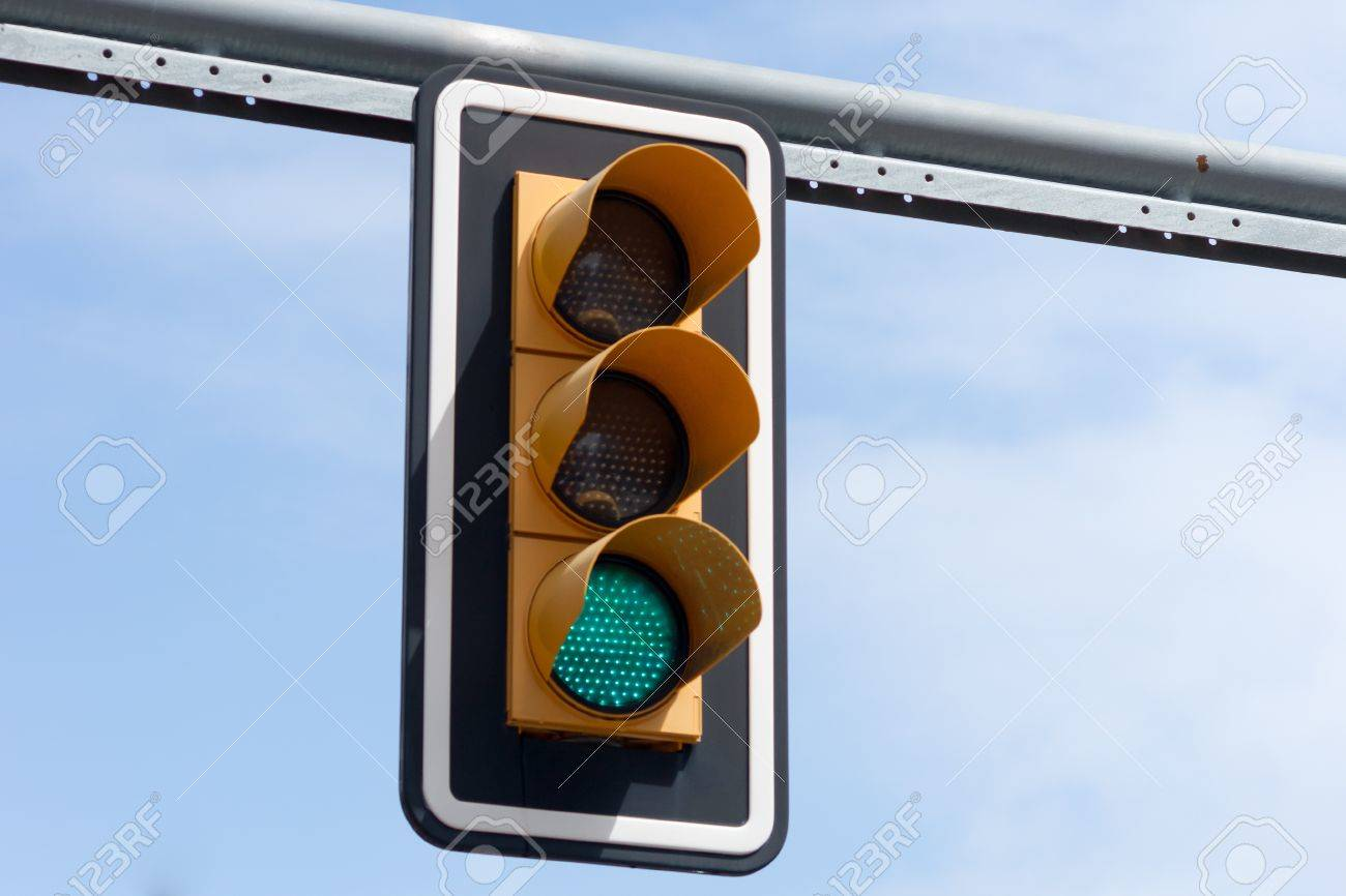 green LED traffic light above a road Stock Photo - 13124639