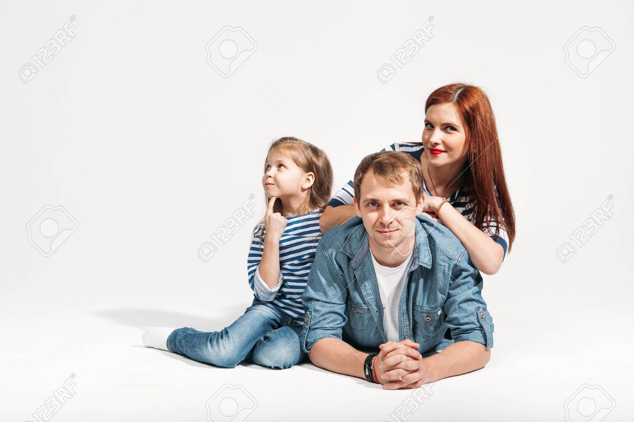 Happy funny family portrait lying on white background isolated stock photo 78584521