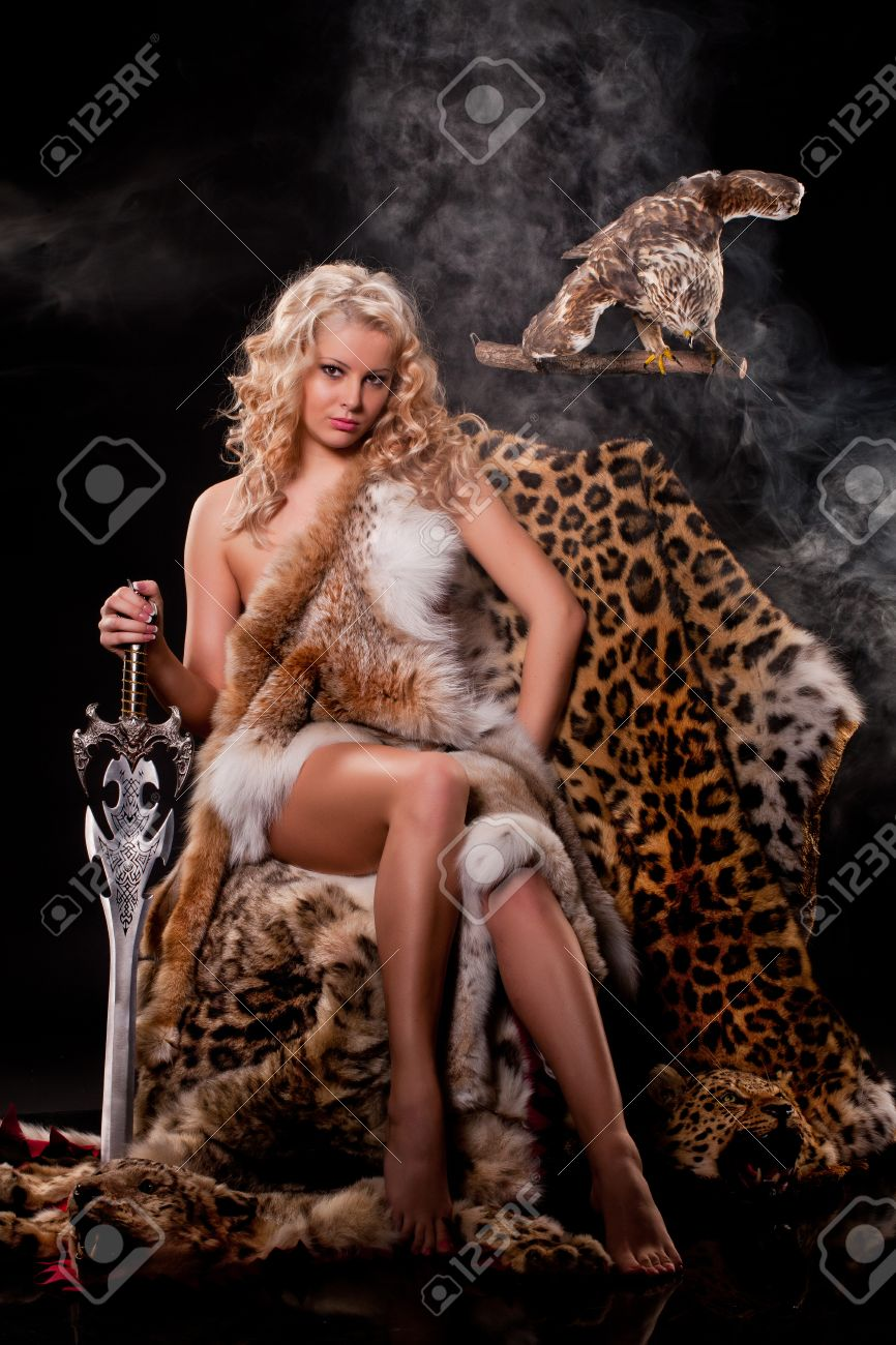 Stock Photo - Young beautiful naked woman in fur
