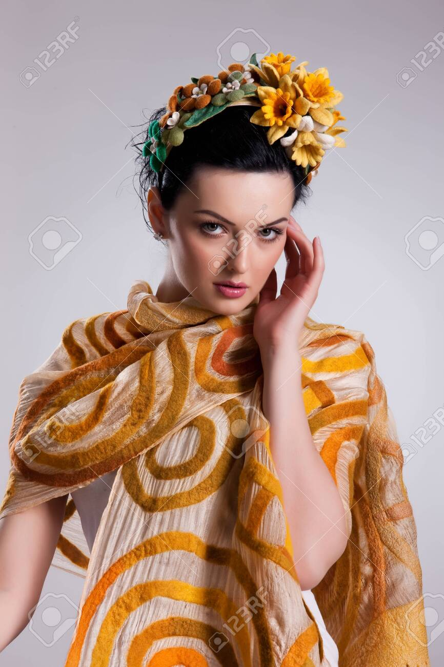 Young attractive woman dressed in fashionable handmade clothing on isolated background - 128432243