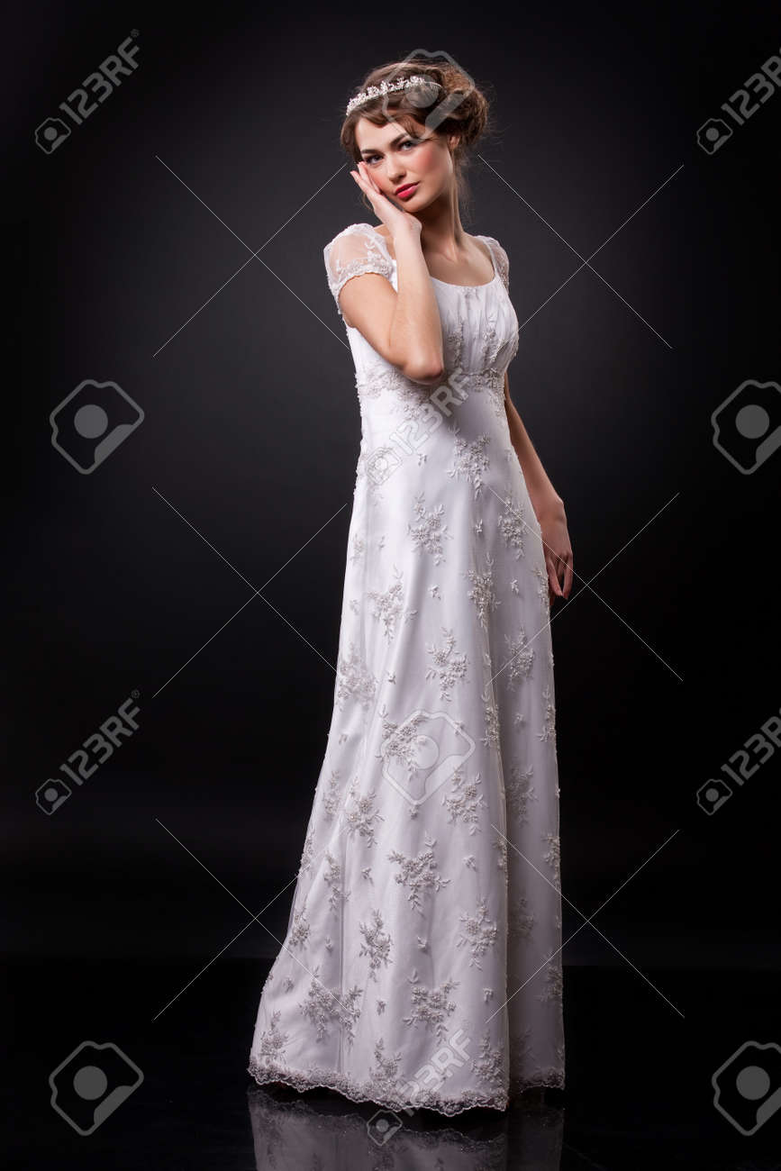 Young beautiful woman in a fashionable wedding dress on a black background - 160519059