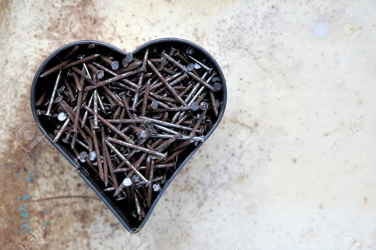 Rusted Metal Nails In A Heart Shape, Spotty Background And Text ...