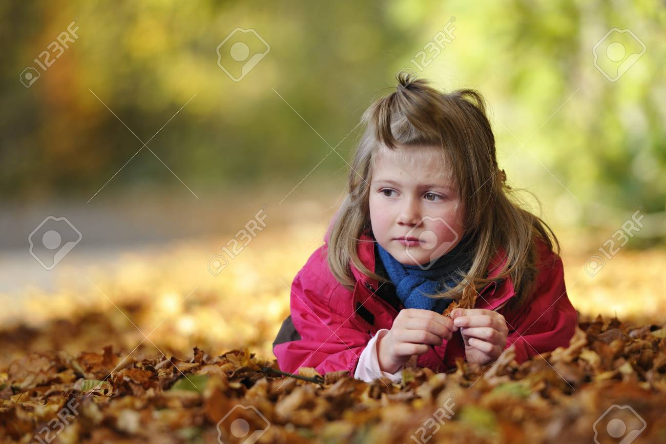 Cute girl in autumn leaves Stock Photo - 10309605