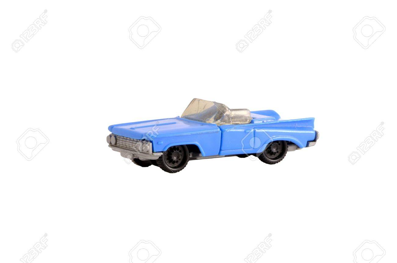Funky old dirty plastic small toy blue cabriolet car on white Stock Photo - 7591921