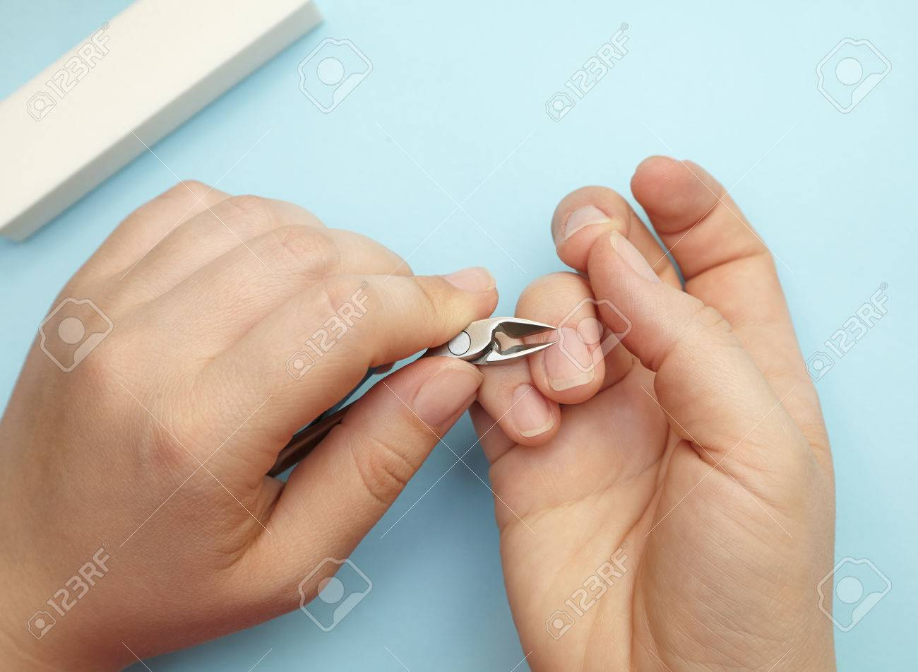Manicure Of A Woman\'s Hand, Cuts Cuticles By Cut Nippers, Self-care ...