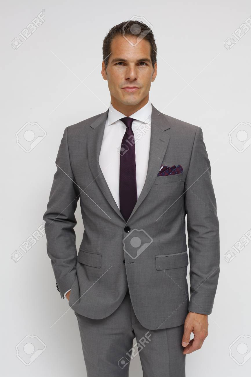 89c9c791b162 man with gray suit, white shirt, dark red tie and dark red handkerchief  Stock
