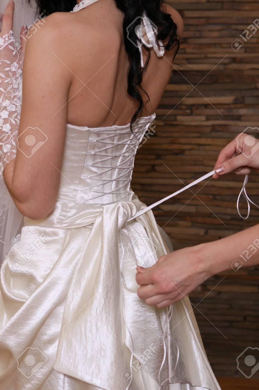 Bride preparing for wedding dress Stock Photo - 8919629