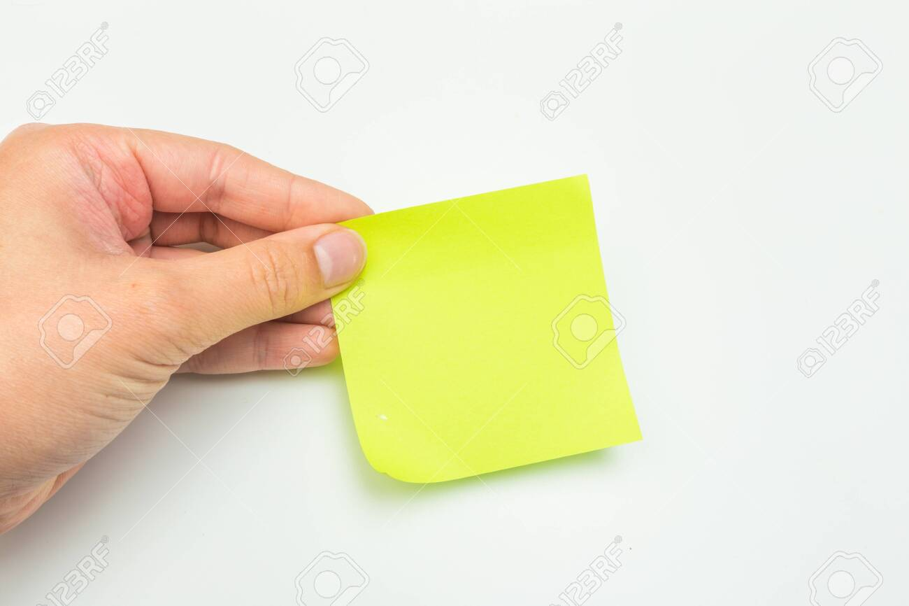 Green post-it note with hand on white background - Image - 126214218
