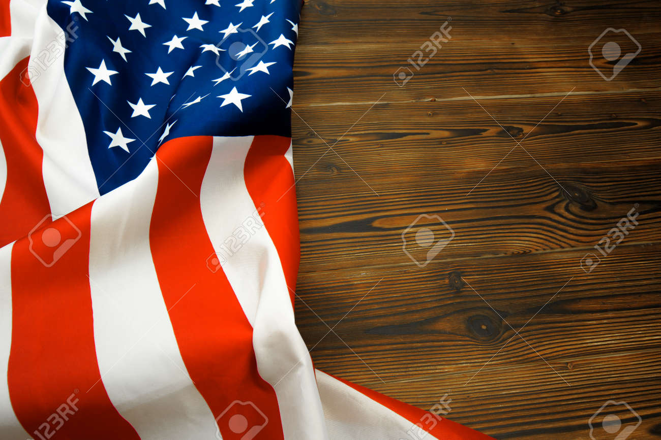 American flag on a old wooden desk top view - Image - 126987853
