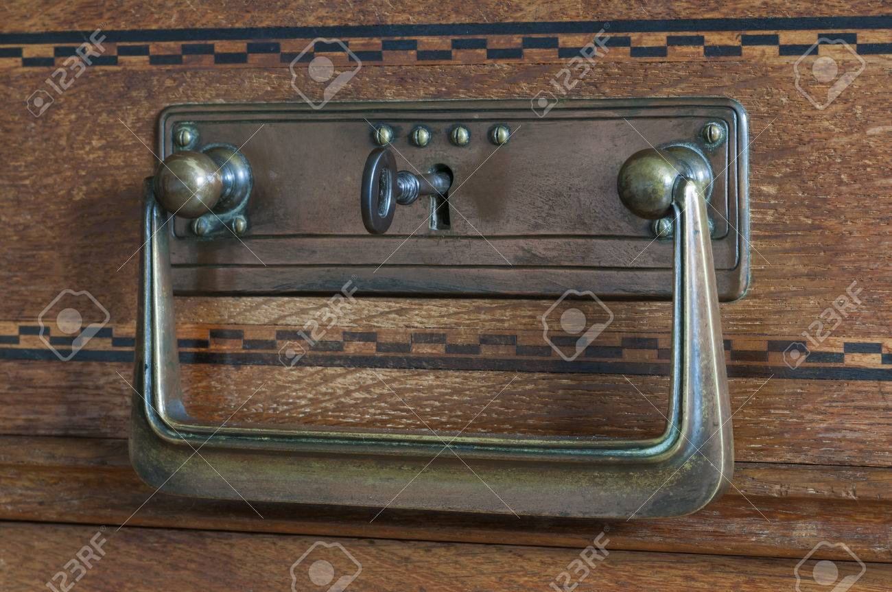 Security on an old cabinet, key in the door lock. Stock Photo - 36671135 - Security On An Old Cabinet, Key In The Door Lock. Stock Photo