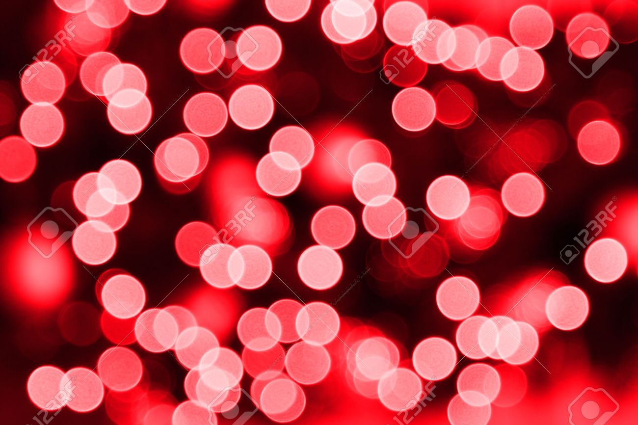 Red Christmas.Background Of Blurred Red Christmas Lights