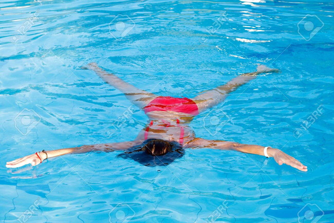 Young woman learn to swimming. Float on the water Stock Photo - 7710952
