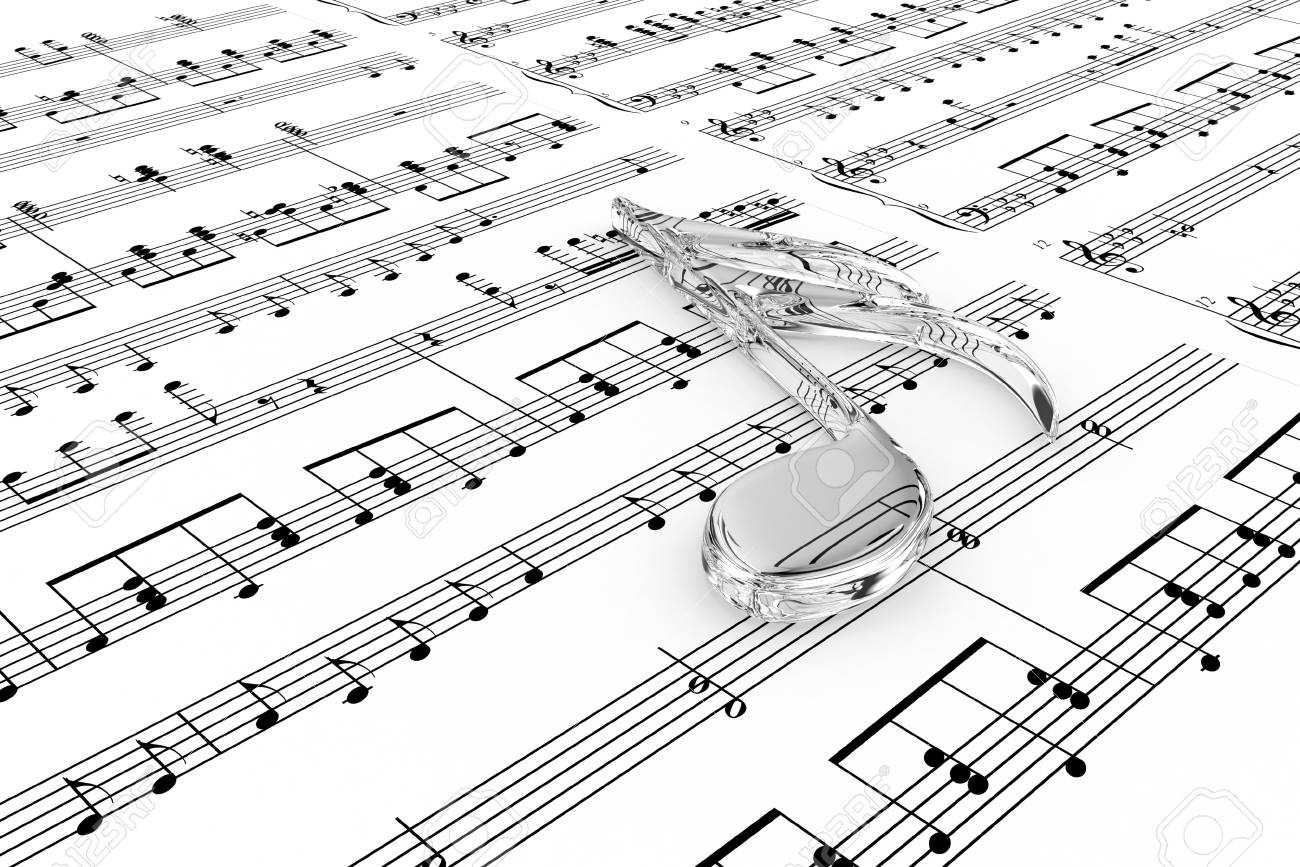 Glass musical note on a  background written notes Stock Photo - 14013389
