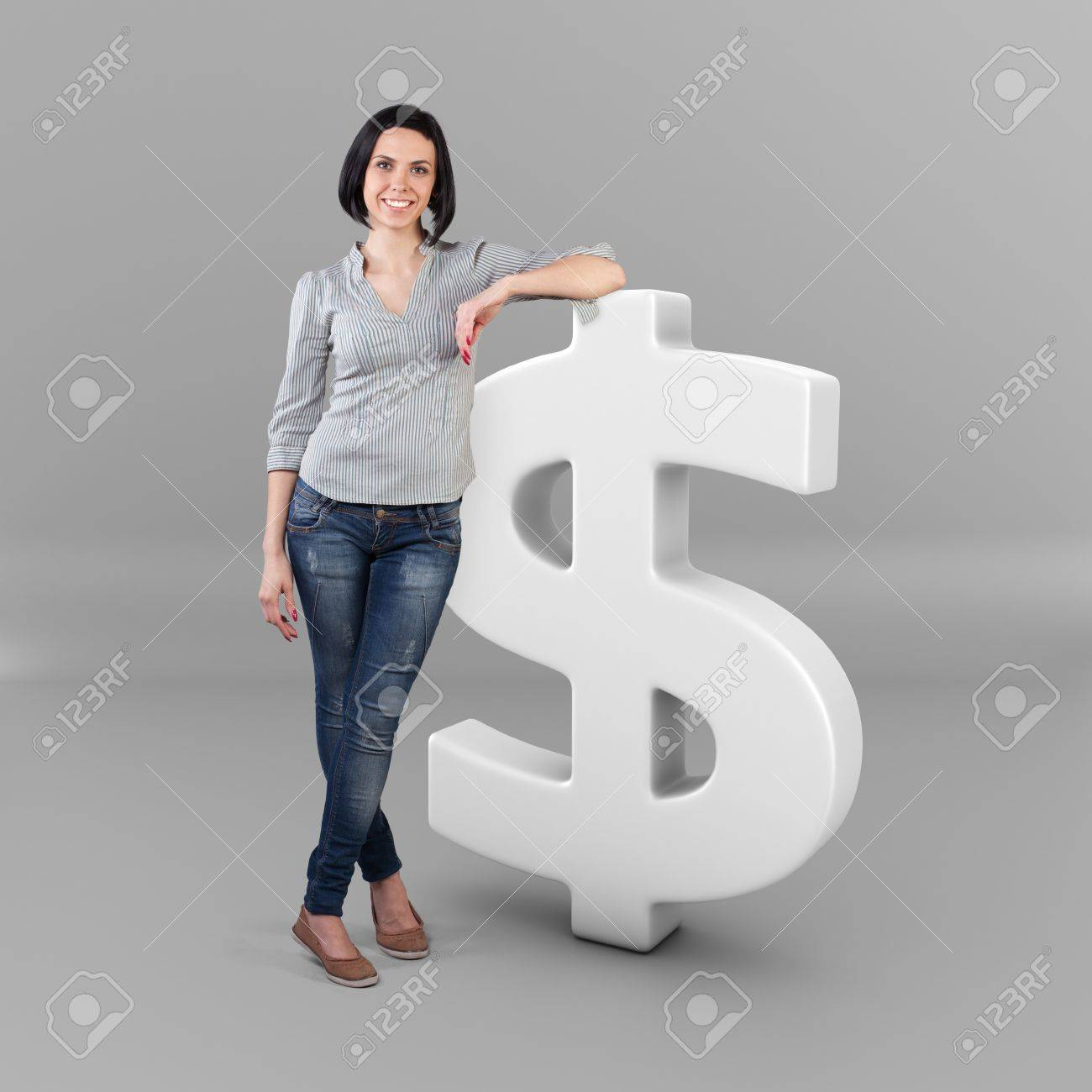 Beautiful girl stand with a big dollar symbol Stock Photo - 19404809
