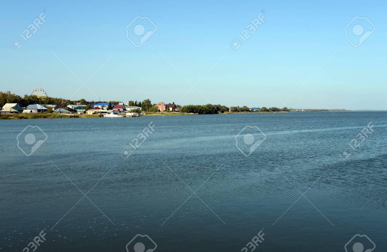 Mamontovo village on the shore of lake Big Island. Altai territory. Russia - 130513902