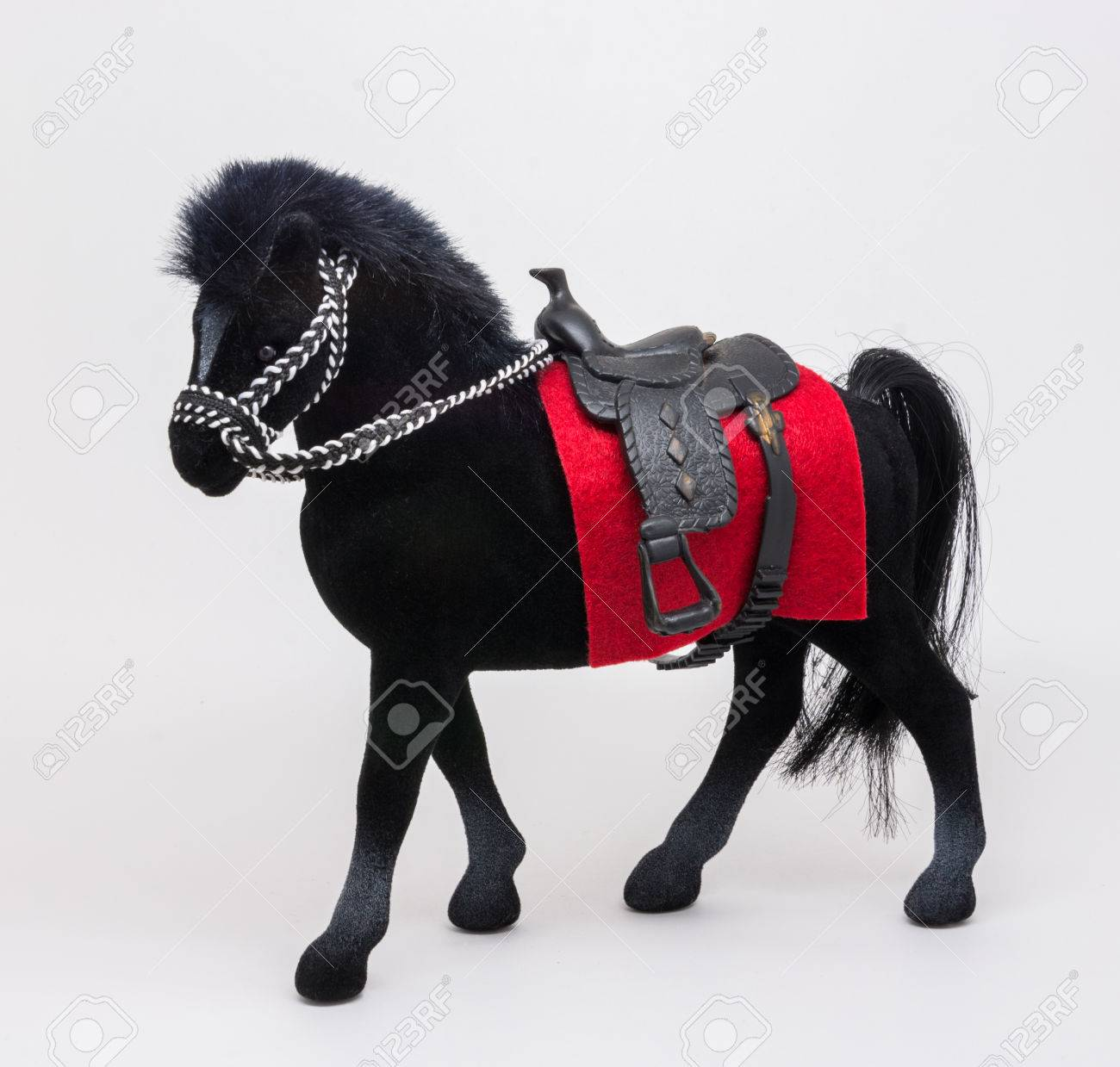 A Small Beautiful Black Horse Toy With A Red Cape And A Seat Stock Photo Picture And Royalty Free Image Image 27431699