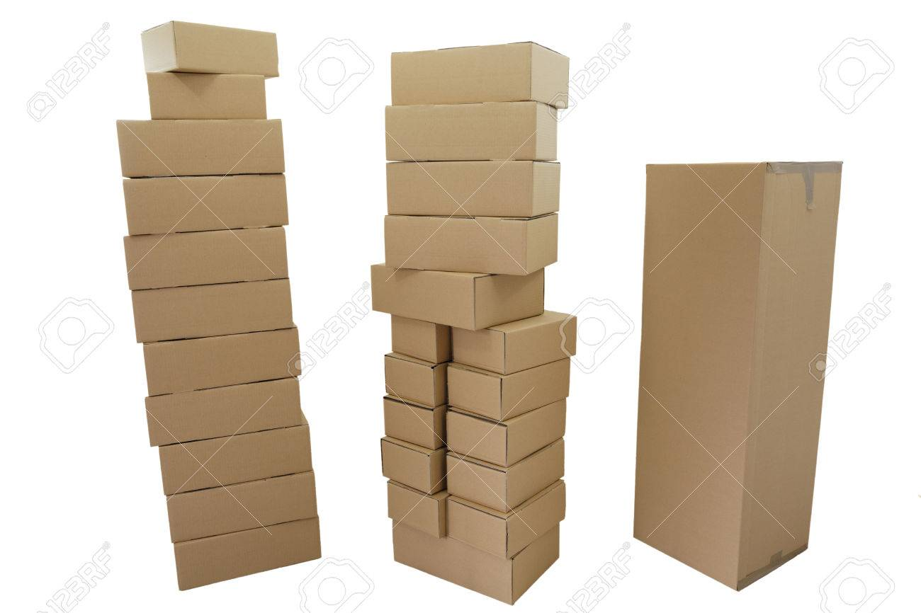 uncoated stacked boxes in brown on white background stock photo